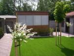 Een beetje groen in de tuin zorgt voor een mooi plaatje